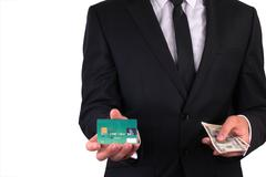 Businessman with credit card and money Stock Photos