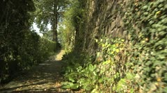 POV Walking on Trail with Stone Wall in Carona, Switzerland Stock Footage