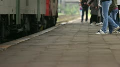 Train stop with waiting people Stock Footage