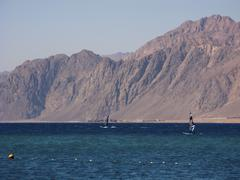 windsurfers are in the dahab's gulf - stock photo