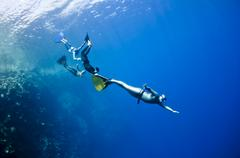 funny freediving adventures at the red sea - stock photo