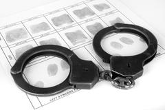 handcuff and fingerprint - stock photo