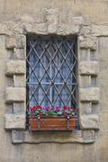 Ancient window with iron lattice Stock Photos