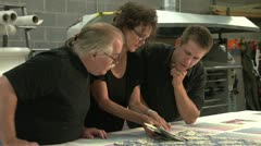 Team checking colors at a printing company Stock Footage