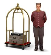 Bellhop with luggage cart Stock Photos