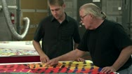 Stock Video Footage of Team checking colors at a printing company