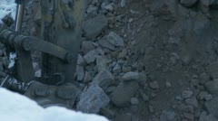 Excavating rocks Stock Footage