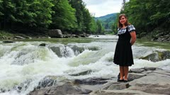 Woman Stands In Front Waterfall - stock footage