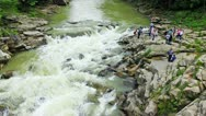 Tourists On Shore Near Waterfall Stock Footage