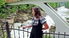 Woman On Viewing Platform Under Bridge Stock Footage