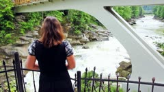Woman On Viewing Platform Looks On Waterfall Stock Footage
