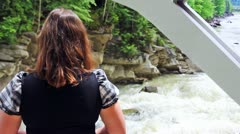 Woman Stands Back And Looks On Waterfall Stock Footage