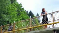 Woman On Bridge Then Panorama To Waterfall Stock Footage