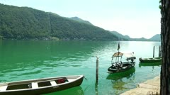 Boats Moored at Lake Lugano in Morcote, Switzerland - stock footage