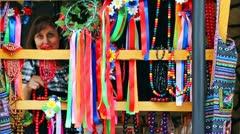 Woman Tries Ukrainian Folk Ornaments On Market Stock Footage