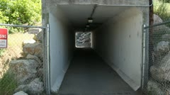 Running through a tunnel on an army base 3 Stock Footage
