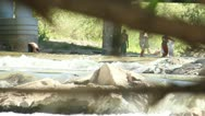 Kids playing in the river Stock Footage