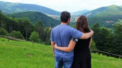 Couple Stand On Top And Look At Mountain Stock Footage