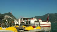 Tourist Boat Moored at Lake Lugano Stock Footage