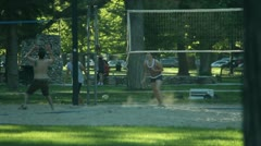 Playing volley ball in the sand 10 Stock Footage