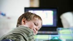 Little boy watching TV,backside view Stock Footage