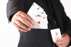 Man's hand hold the four aces Stock Photos