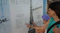 Tourists Looking at Info About Eiffel Tower Stock Footage