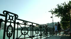 Mother and Daughter Walking by Lake Lugano in Switzerland - stock footage