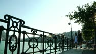 Mother and Daughter Walking by Lake Lugano in Switzerland Stock Footage