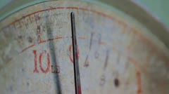 Old weighing/measuring scales needle moving Stock Footage