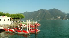Bright, Red Paddleboats Moored at Lake Lugano Stock Footage