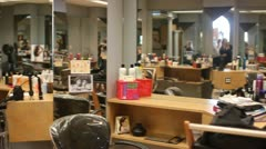 Stock Video Footage of WS Pan Across Interior of Hair Salon with Stylist