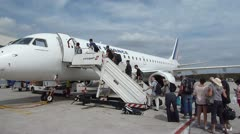 Passengers Boarding Plane at Charles de Gaulle Airport Stock Footage