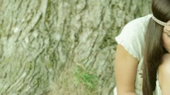 Romantic young woman posing outdoor. Stock Footage