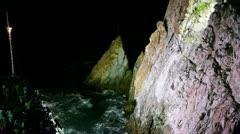 Diver jumps off at night at La Quebrada Stock Footage