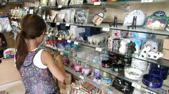 Cute Little Girl Shopping for Souvenirs in Paris Stock Footage