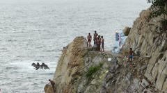 Several men climbing the rocky walls before dive show Stock Footage