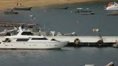 Several boats docked at the end marina inside Acapulco Bay Stock Footage