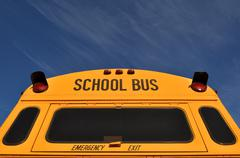 back of school bus with blue sky - stock photo
