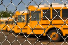 multiple school bus with blue sky - stock photo