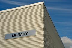 outdoor library building with blue sky and clouds - stock photo