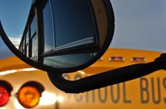 school bus mirror reflection - stock photo
