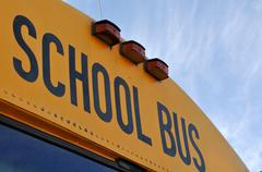 school bus close up with blue sky - stock photo