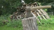 Axe at rest in a block of wood Stock Footage