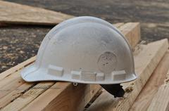 hard hat and lumber - stock photo