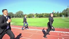 Slow motion business men finishing run Stock Footage