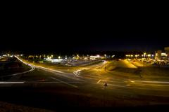 straight night highway with car's traces - stock photo