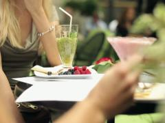 Couple with desserts in cafe, steadicam shot NTSC Stock Footage