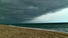 Severe storm clouds moving in on beach 02 Stock Footage