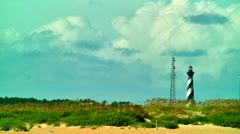 Lighthouse cape hatteras and cell phone tower Stock Footage